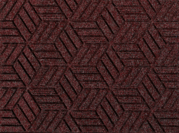 Close up view of a Maroon Waterhog Legacy Eco floor mat detailing the high tech floor surface pattern of the walk off mat