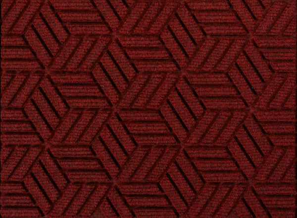 Close up view of a Regal Red Waterhog Legacy Eco entrance mat detailing the high tech floor surface pattern of the walk off mat