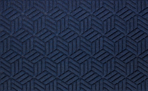 Close up view of a Navy Waterhog Legacy Classic entrance matting detailing the high tech floor surface pattern of the front door mat