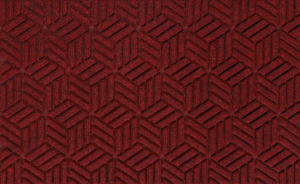 Close up view of a Red/Black Waterhog Legacy Classic entrance matting detailing the high tech geo floor surface pattern of the front door mat