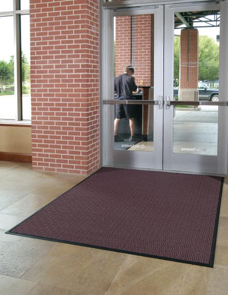 Waterhog Masterpiece Select Front Door Mat placed inside a school entrance