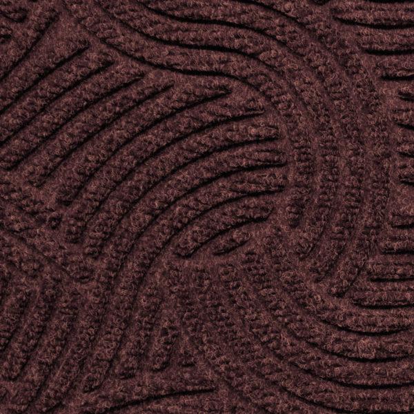 Close up view of Waterhog Plus Swirl Pattern Maroon showing swirling pattern of the floor mat