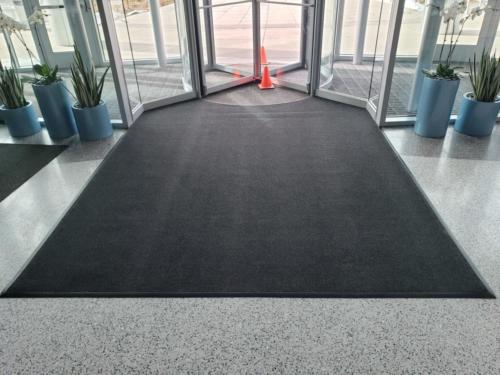 Custom Cut Berber entrance matting cut in around revolving door - Denver, CO